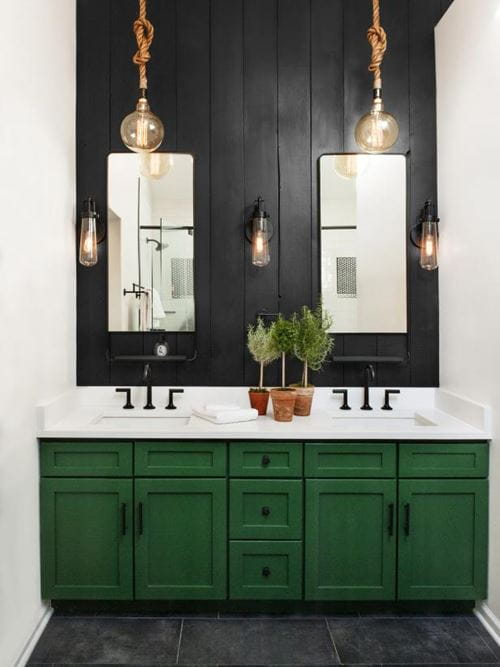 Black shiplap bathroom with green cabinet and rope lighting
