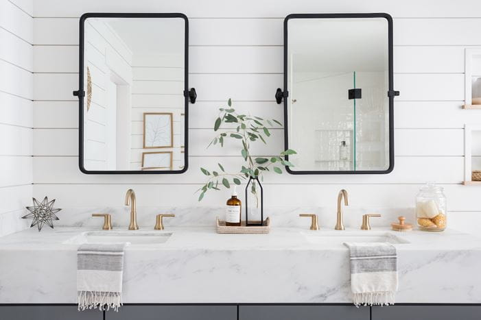 Beautiful white shiplap bathroom with gold accents