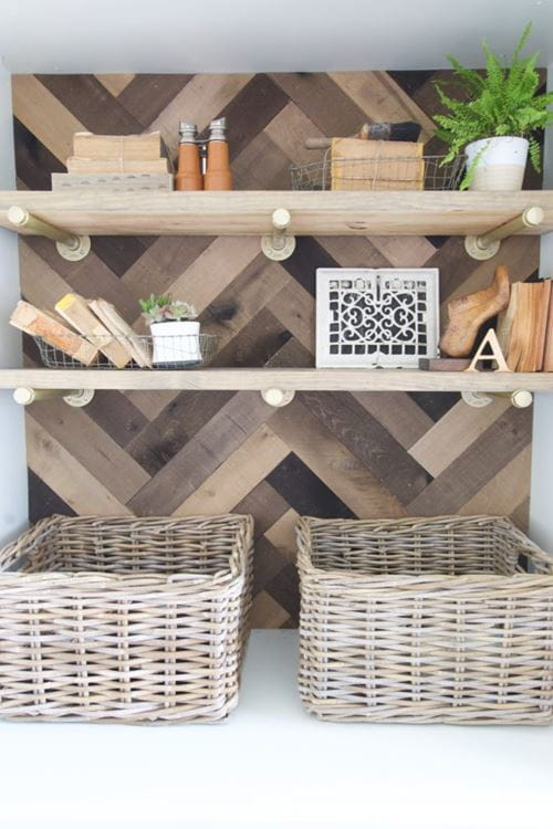 Weathered wood accent boards as cabinet or bookcase backing herringbone pattern