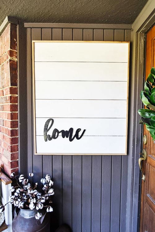 White smooth shiplap sign with frame and home word attached