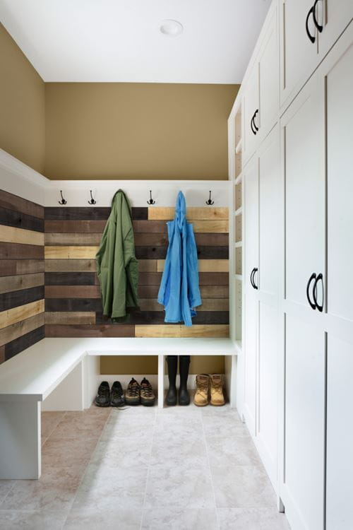 Weathered wood accent boards in mixed colors installed in mudroom entryway area
