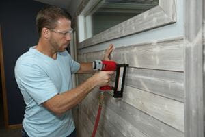 Installing UFP-Edge Smoke White Charred Wood shiplap to an accent wall