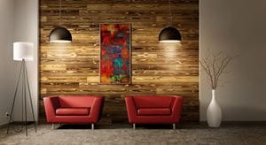 Charred Wood on accent wall with red chairs