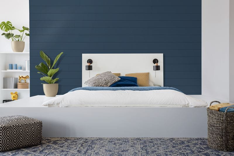 Timeless nickel gap shiplap bedroom accent wall in cavalry blue