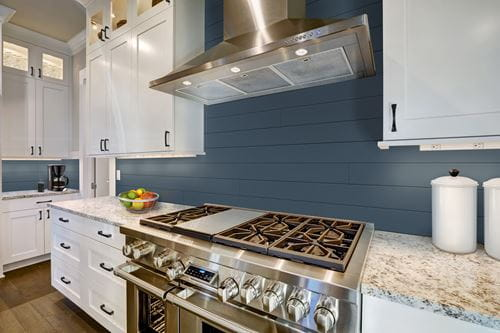 Timeless nickel gap shiplap in Cavalry Blue as kitchen backsplash