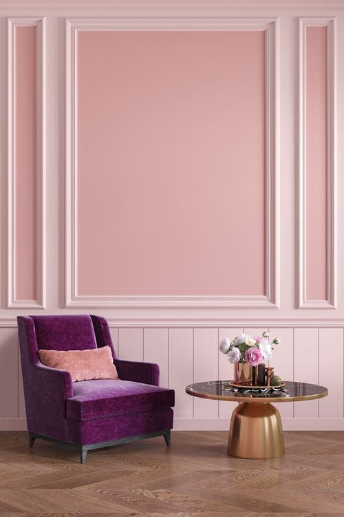 Timeless light pink shiplap under as wainscoting under chair rail with pink board and batten wall