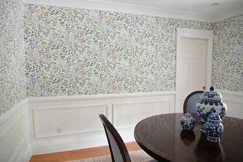 White wainscoting board and batten in dining room with floral wallpaper