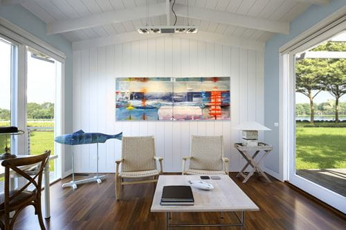 Timeless Farmhouse White Shiplap Living Room With Colorful Painting
