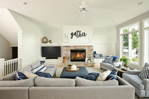 Timeless Farmhouse White Shiplap Family Room with fireplace and couches