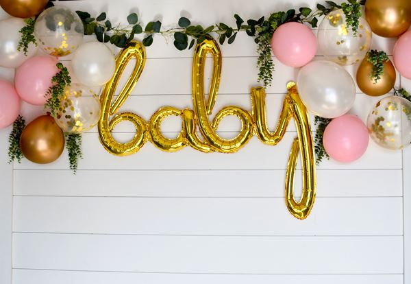 Decorated shiplap wall baby sign
