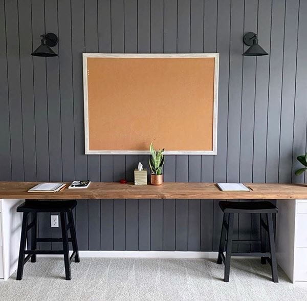 Homework station room with vertical dark gray shiplap and corkboard