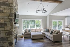 Timeless Shiplap Ceiling With Stone Fireplace in Living Room