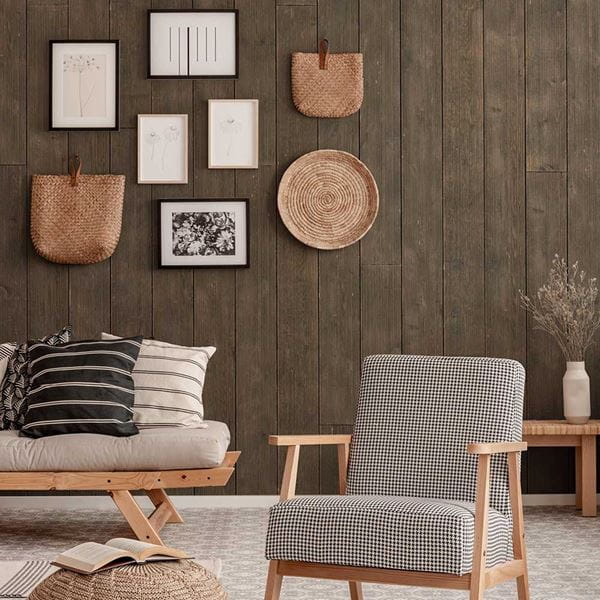 Rustic Dark Brown vertical shiplap living room space with textured wall art and seating